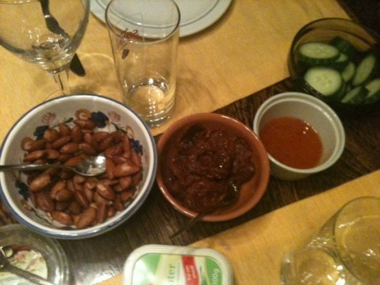 Salted almonds, olive mix, chili sauce and cucumber