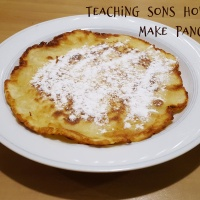 Teaching sons how to make pancakes